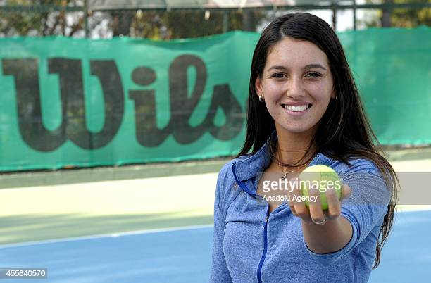 Open Junior Girls' Doubles winner from Turkey Ipek Soylu poses with a tennis ball as she gives an interview at Adana Tennis Mountain and Water Sports...