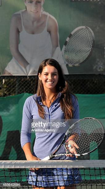 Open Junior Girls' Doubles winner from Turkey Ipek Soylu poses with her racket as she gives an interview at Adana Tennis Mountain and Water Sports...