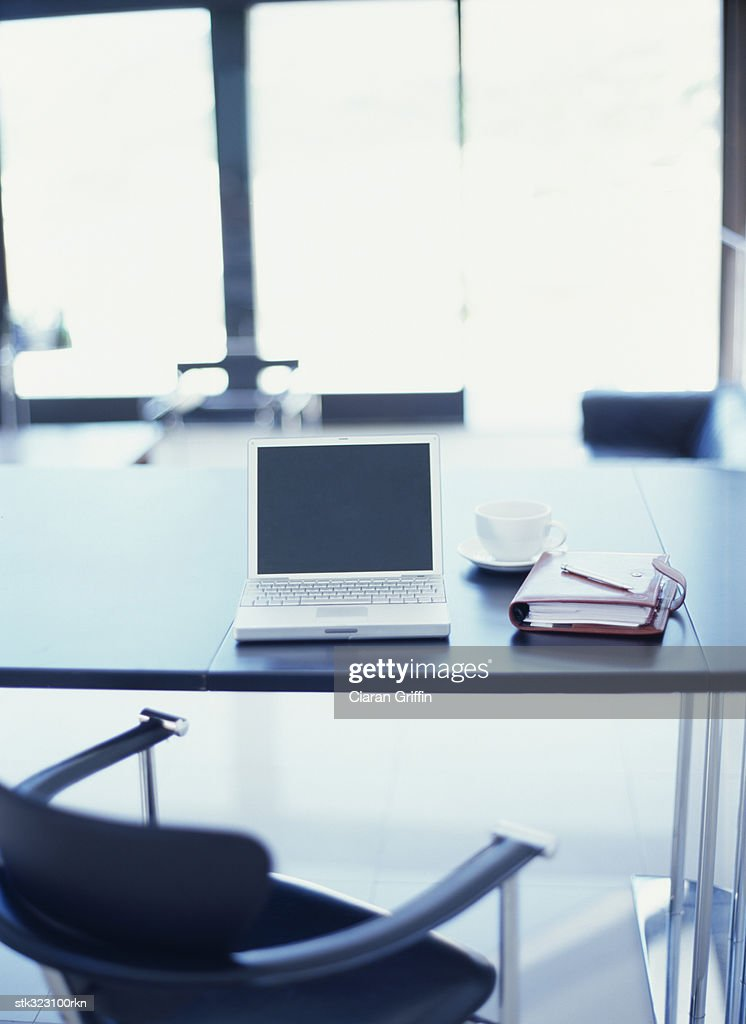 open laptop and a personal organizer on an office table : Stock Photo