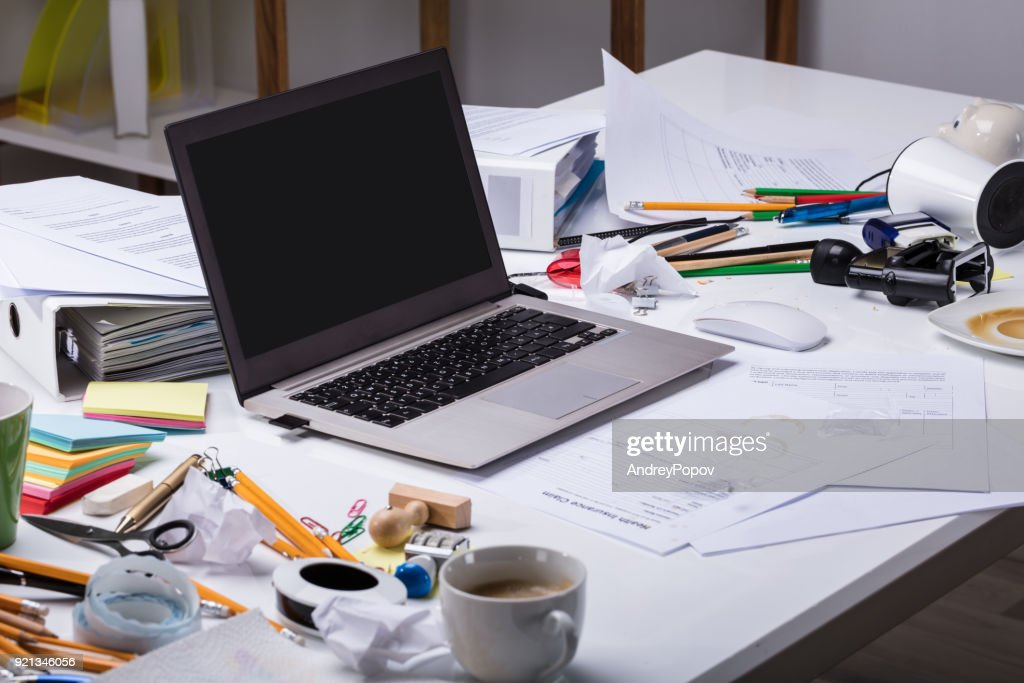 Open Laptop On The Messy Desk : Stock Photo