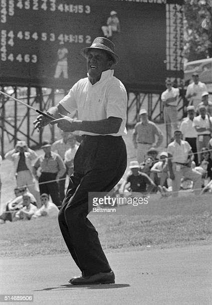 US Open leader Tommy Bolt cries with delight as he drops in a birdie putt on the 9th green during third round play of the 1958 US Open Championship...