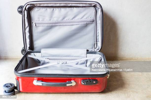 Open Luggage On Floor At Home