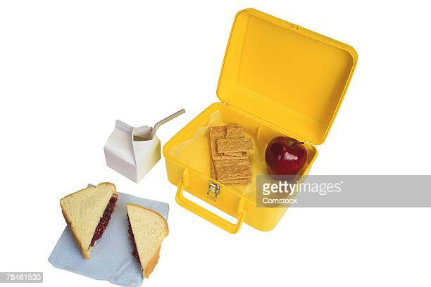 open lunchbox with food - milk carton stock photos and pictures