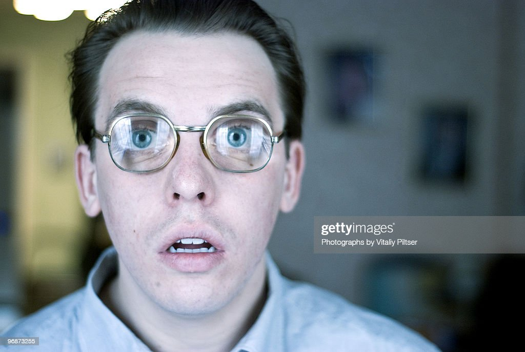 Open mouth, wide eyed, nerdy thick glasses. : Stock Photo