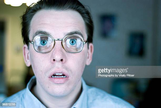 open mouth, wide eyed, nerdy thick glasses. - staring stock photos and pictures