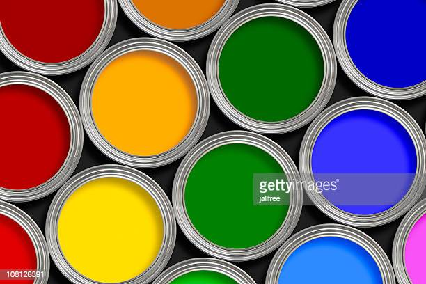 Open multi-colored paint tins from above