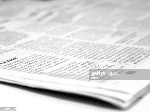 Open newspaper focused on a small corner of printed text