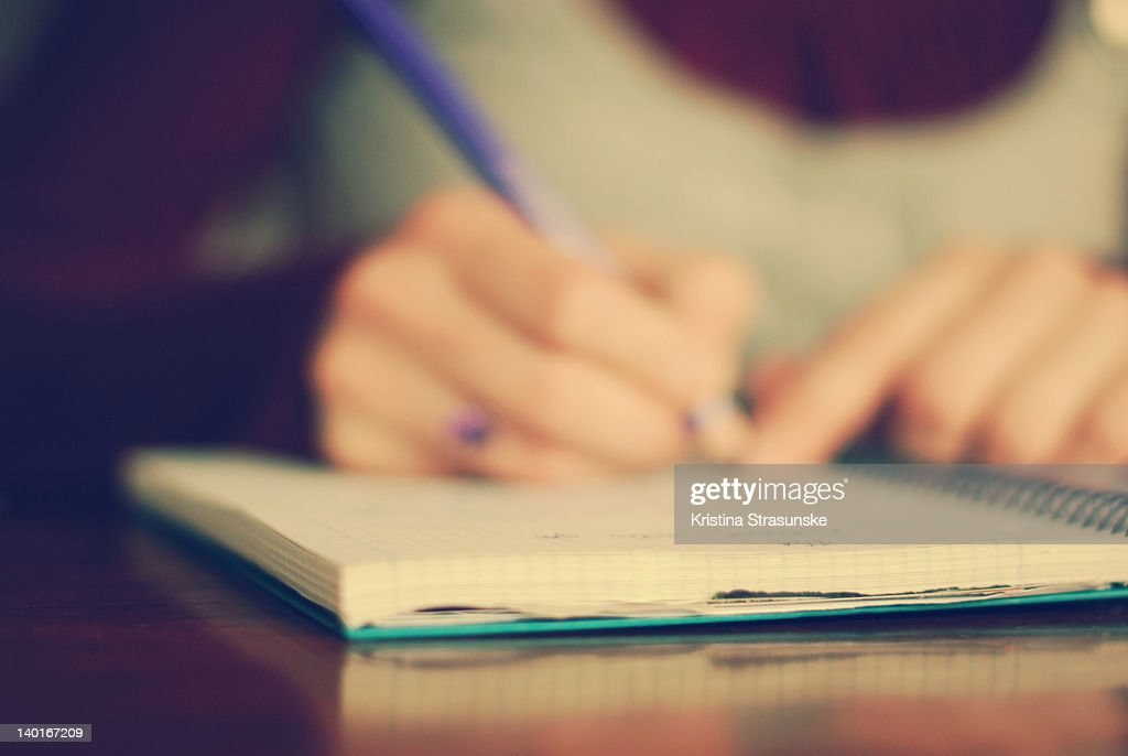 Open notebook and hands : Stock Photo