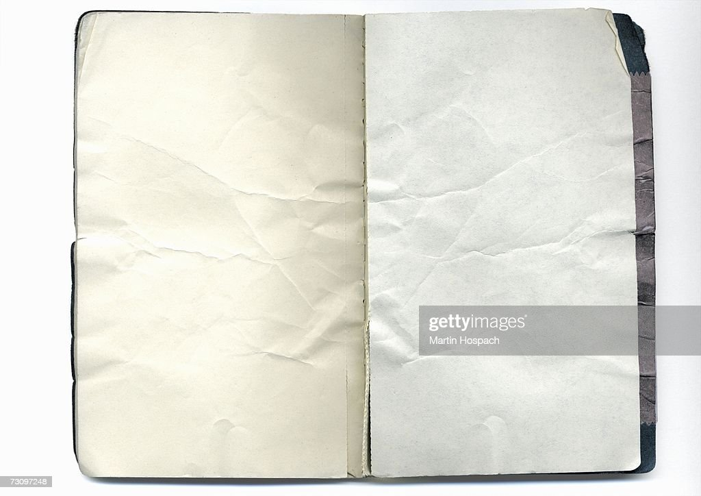 Open notebook with crumpled pages : Stock Photo