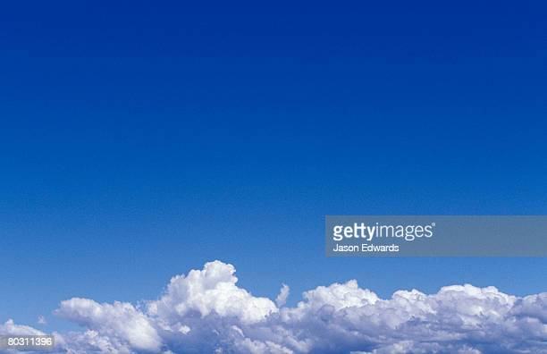 puffy white cloud formations in a vast sky of shades of blue. - continental_shelf stock pictures, royalty-free photos & images
