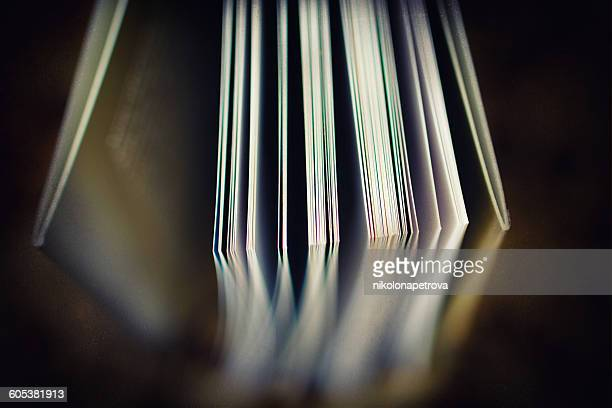 Open pages in a book reflected in a table