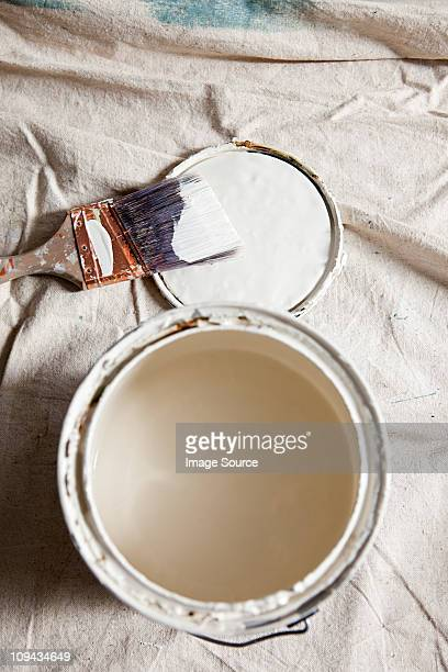 Open paint tin with white paint