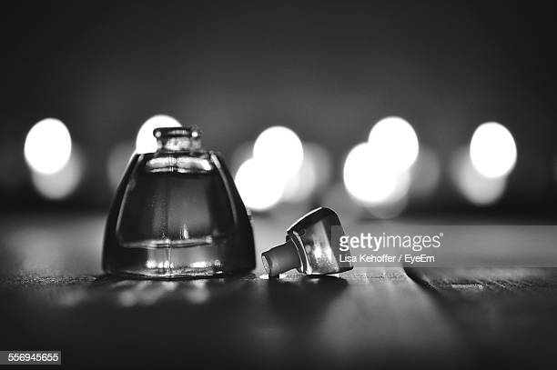 Open Perfume Bottle On Table At Home