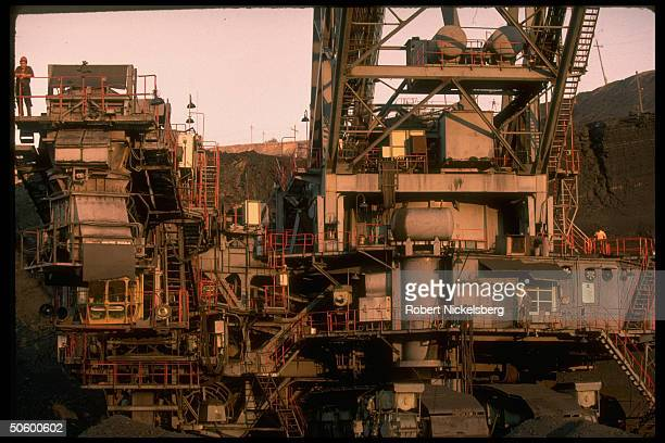Open pit coal mine machinery in operation at 1 of world's largest coal mine ops in Central Steppes region Ekibastuz