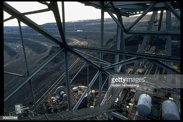 Open pit coal mine op machinery railroad tracked terrain at 1 of world's largest such ops extracting 200000 tons day in Central Steppes region...