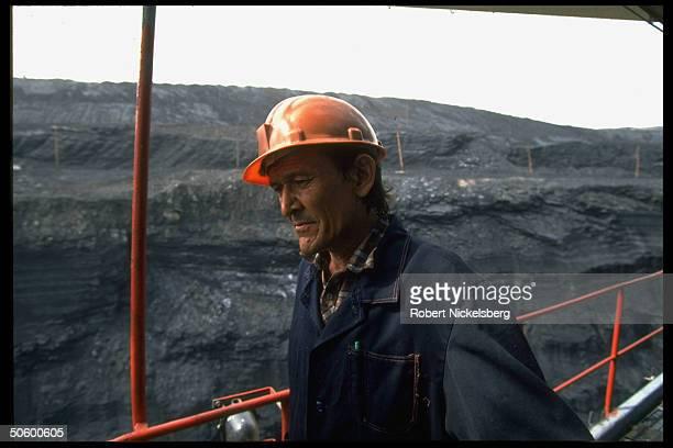Open pit coal mine worker at 1 of world's largest coal mine ops in Central Steppes region Ekibastuz