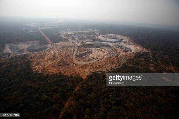 Open pit excavations at Comide SPRL's Mashitu copper mine operated by Eurasian Natural Resources Corp are seen surrounded by forest in this aerial...
