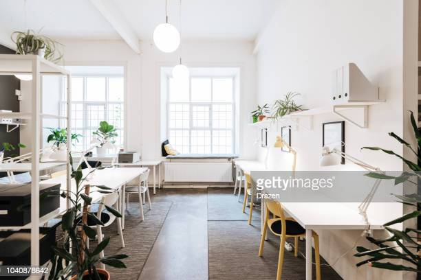 open plan co-working office in sweden - real estate office stock photos and pictures