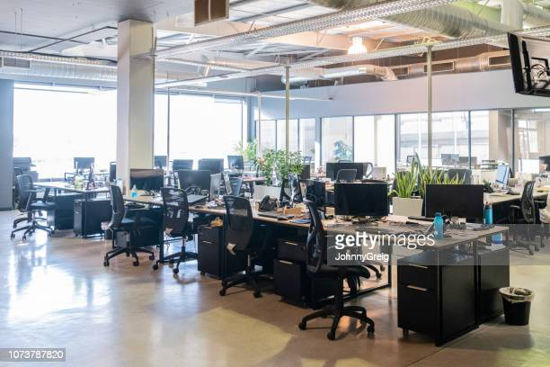 open plan office with work stations and computers - no people stock pictures, royalty-free photos & images