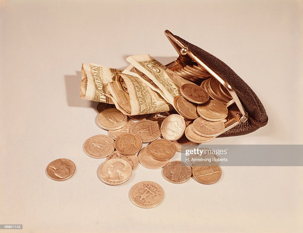 Open purse filled with change : News Photo