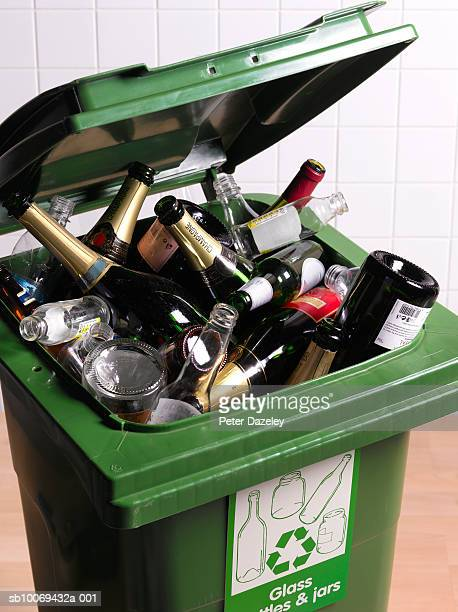 open recycling bin with full of glass bottles, close-up - morning after party stock pictures, royalty-free photos & images