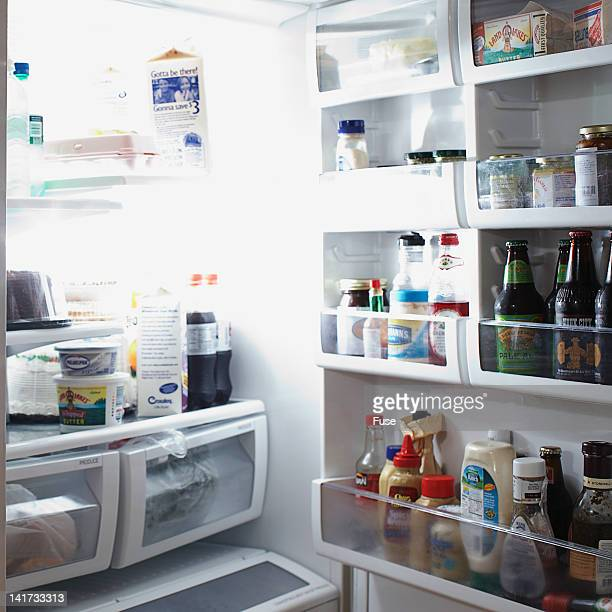 open refrigerator - milk carton stock photos and pictures