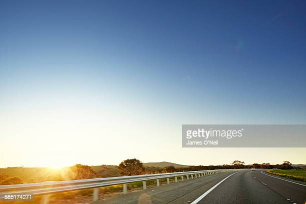 open road in australia - clear sky stock pictures, royalty-free photos & images