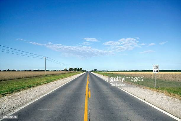 Open road through farmland of the midwest USA