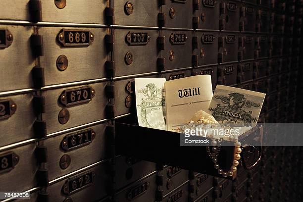 Open safe deposit box in bank vault