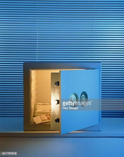 Open safe with paper money inside