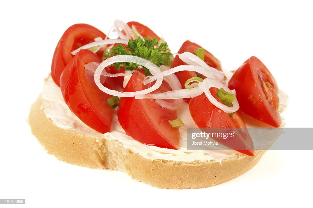 Open sandwich with tomatoes and onion : Stock Photo