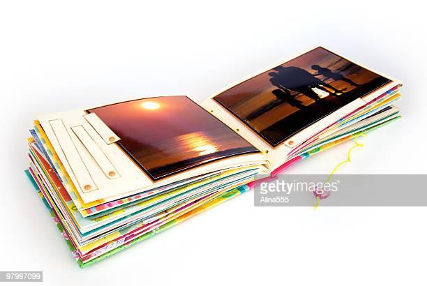 Open scrapbook album on white