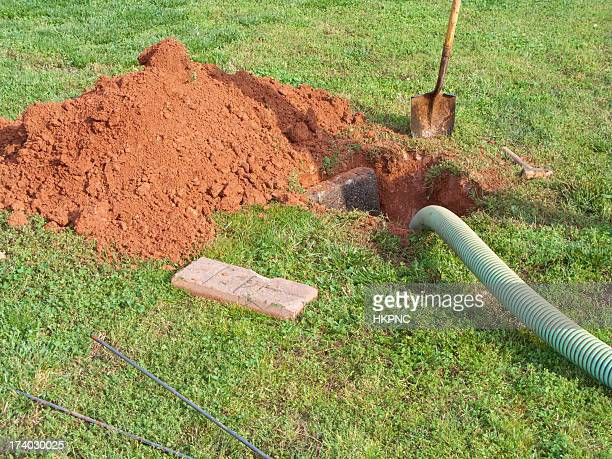 open septic tank in yard while bring pumped out - septic tank stock photos and pictures