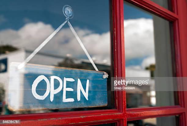 Open sign hanging on store door