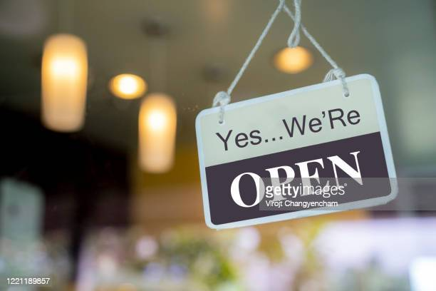 open sign hanging on window glass at coffee shop - small business stock pictures, royalty-free photos & images