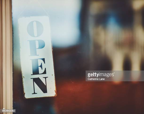 open sign hung in shop window - open for business stock pictures, royalty-free photos & images