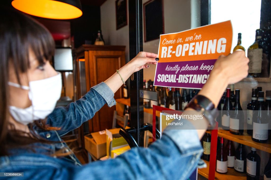 Open sign in a small business shop after Covid-19 pandemic : Stock Photo