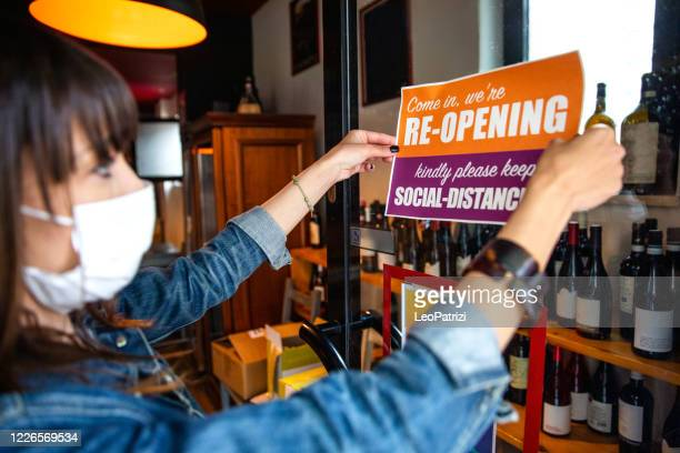 open sign in a small business shop after covid-19 pandemic - opening event stock pictures, royalty-free photos & images