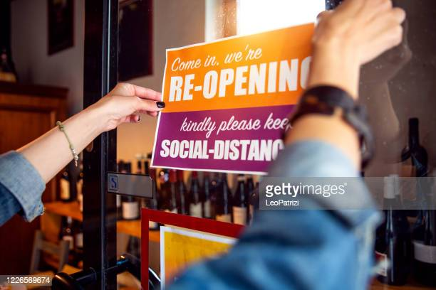 open sign in a small business shop after covid-19 pandemic - store opening stock pictures, royalty-free photos & images