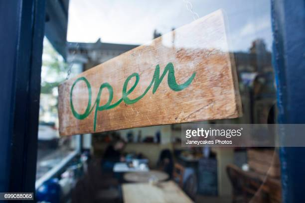 Open sign in window of cafe