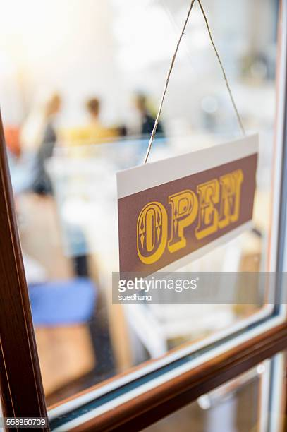 Open sign on cafe door, close-up