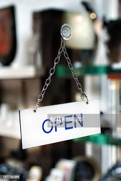Open sign on shop window door