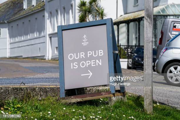 Open signage outside the Working Boat pub at the Greenbank Hotel, on April 12, 2021 in Falmouth, England. England has taken a significant step in...