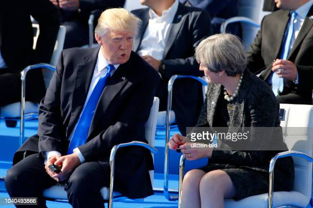 Open strike with British Prime Minister Theresa May and US President Donald Trump during the handed over ceremony of the new headquarters to Nato on...