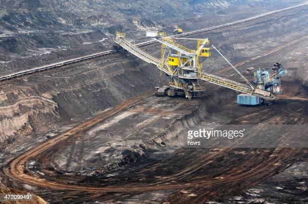 Open Strip Coal mine with Bucket-wheel excavator at conveyor belt