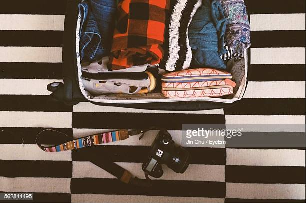 Open Suitcase On Bed With Camera