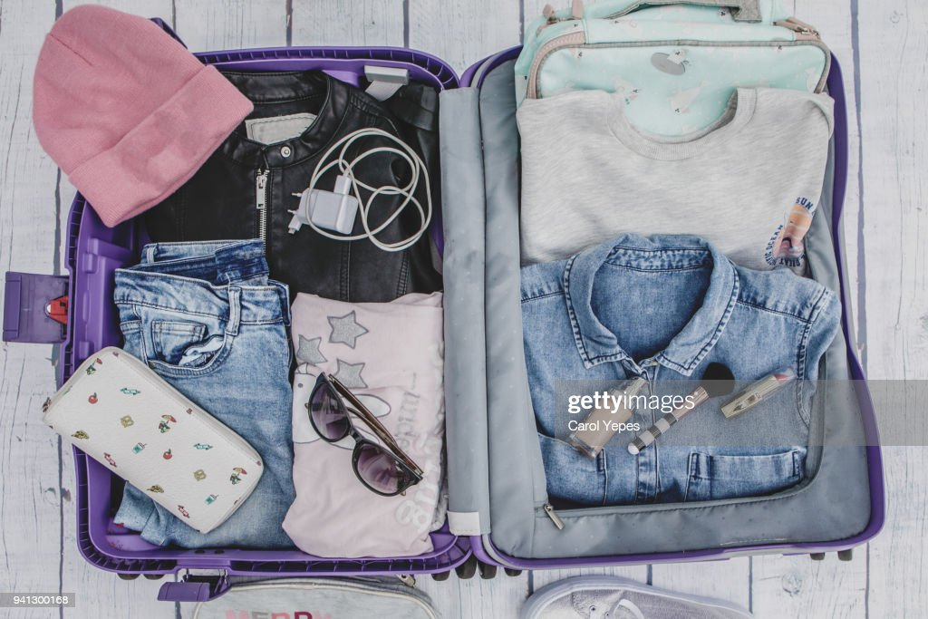 Open Suitcase With Casual Female Clothes High-Res Stock Photo - Getty Images