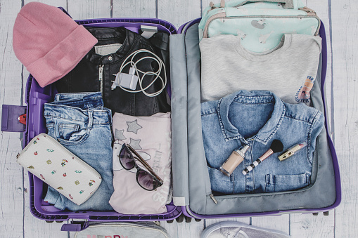 Open suitcase with casual female clothes - gettyimageskorea