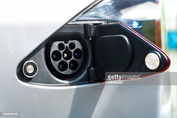 Open tank cap of an electric car