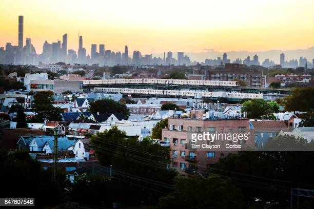 S Open Tennis Tournament DAY ELEVEN Metro trains in Queens New York showing the The Manhattan skyline at sunset shot from the Arthur Ashe Tennis...